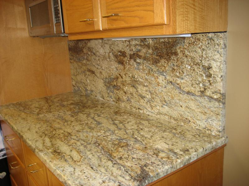 Golden River 3cm Thick Granite On Honey Colored Oak Cabinets. Kitchen In  West Seattle, Washington.